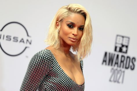 Ciara in Neon Green Swimsuit Charms a Snake